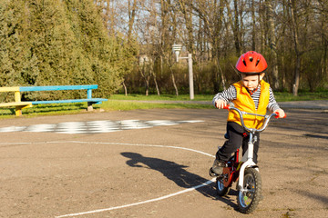 Little boy preparing to ride his bicycle