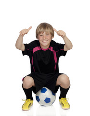 Preteen with a uniform for play soccer sitting on a ball saying