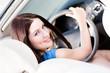 Portrait of pretty female driver turning back