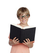 Preteen boy reading a book with glasses