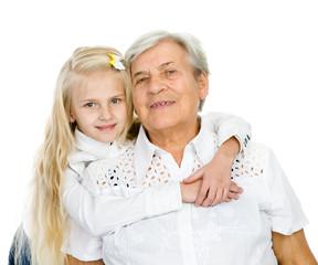 senior Caucasian woman hugging little granddaughter
