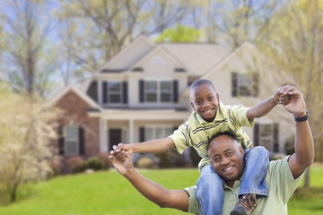 Playful African American Father and Son In Front of Home