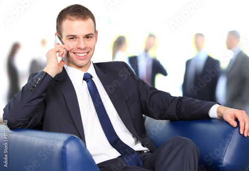 Young businessman enjoying a conversation over cellphone