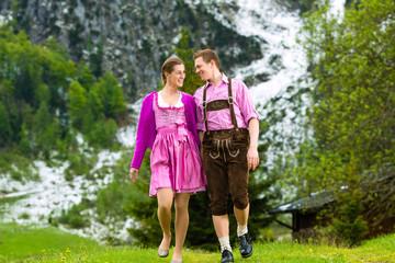 Happy couple hiking in Alpine meadow