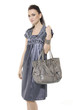 Full length casual young model holding bag