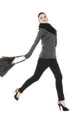 Full length of fashion model with big bag. Isolated on white