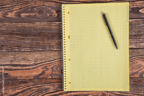 Blank notepad on a wooden table