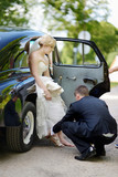 Groom helping bride to put on her shoes