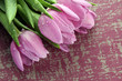 Beautiful bouquet of purple tulips on bright background