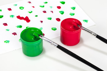 red and green paint boxes with brushes