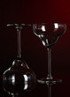 Two glasses on dark red background