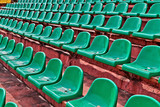 green plastic chairs on a football tribune