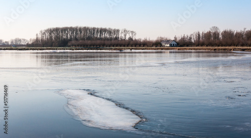 Wide ice surface on a small lake
