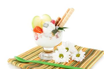 Ice cream with wafer sticks on napkin on white background