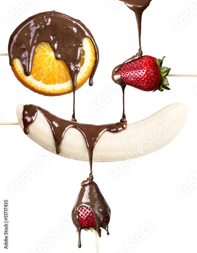 strawberries, orange and banana with chocolate