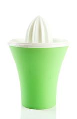 Green plastic citrus juicer isolated on white