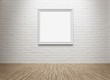 Blank picture frame at the brick wall with clipping path