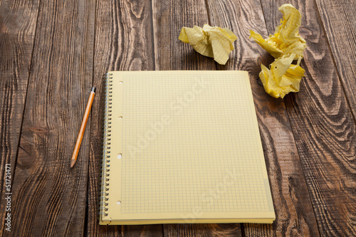 Notepad on a wooden table
