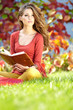 beautiful girl with book in  park