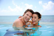Couple Having Fun In Swimming-...