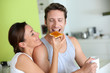 Cheerful couple enjoying breakfast time