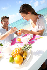 Couple enjoying breakfast in resort