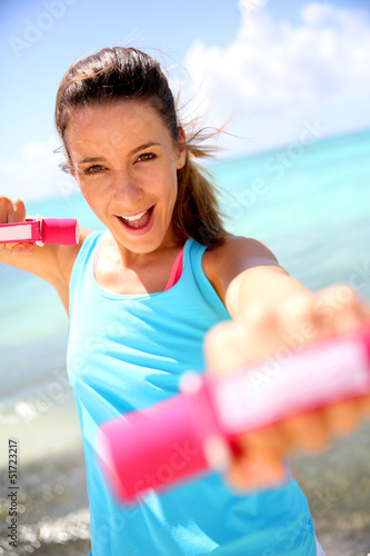 Cheerful girl lifting weights