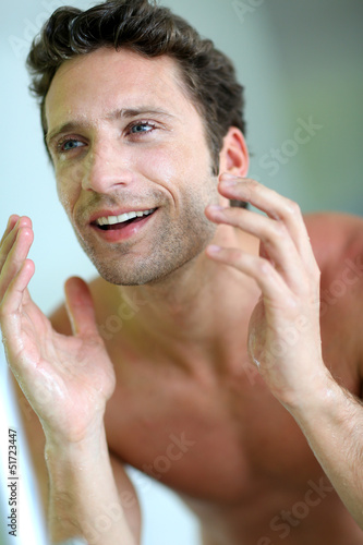 Closeup of handsome guy cleansing his face