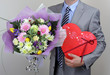 Bouquet of flowers and box of chocolates