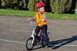 Happy confident little boy on his bike