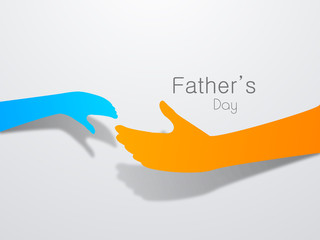 Happy Fathers Day background with a father and child hands on gr