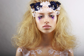 Fantasy. Bright Blond with Unusual Makeup. Creativity