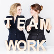 Two business women presenting teamwork