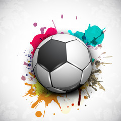 Shiny soccer ball on grungy colorful background and space for yo