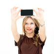 woman looking at a smart phone and taking photo