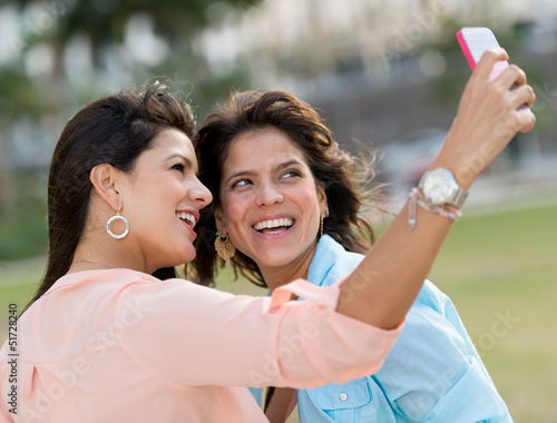 Girls taking a picture with the phone