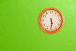Leinwanddruck Bild - Clock showing 5:30 o'clock on a green wall