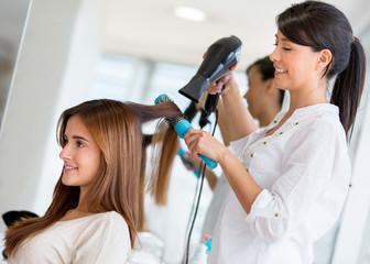 Stylist drying hair
