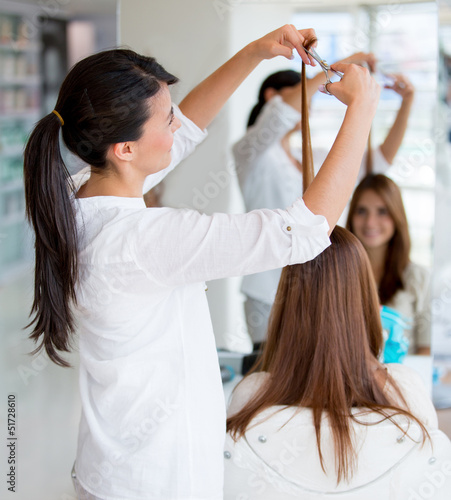 Woman cutting clients hair