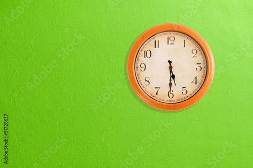 Leinwanddruck Bild Clock showing 5:30 o'clock on a green wall