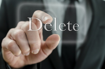 Businessman touching Delete button