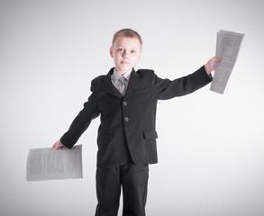 Boy waving bundles of paper