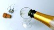 Champagne being poured into flute on white surface