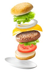 Flying classic hamburger on isolated background