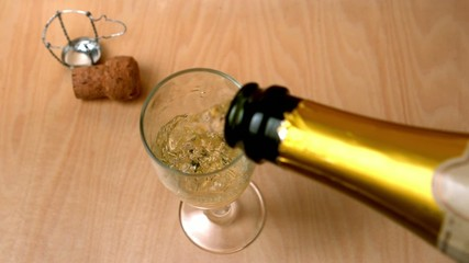 High angle view of champagne being poured into flute