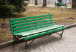 green bench in a public park