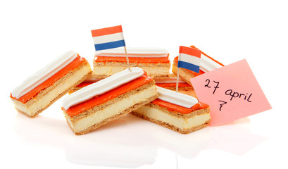 Traditional Dutch pastry called tompouce with flags