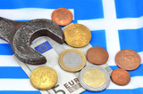 Earning in Greece concept with Euro money, flag and wrench