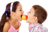 Two kids sharing the apple