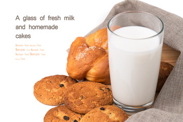A glass of fresh milk and homemade cakes